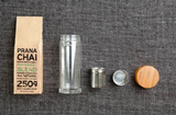 Flat lay Prana Chai Peppermint Blend & Glass Infuser Bottle