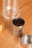 Glass infuser bottle with chai ingredients