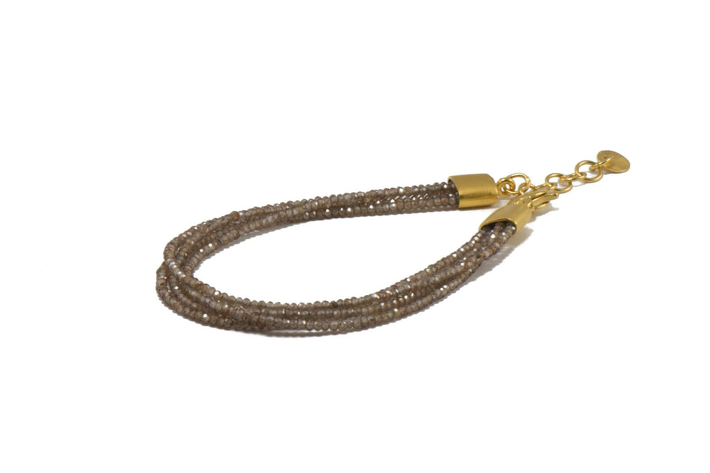 B0824-30 BRACELET-2MM ZIRCON 4 STRAND FAIR TRADE 24K GOLD VERMEIL