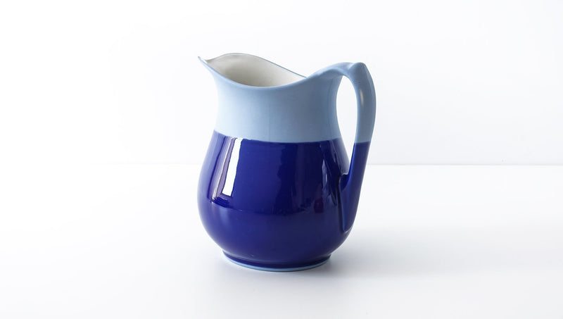 classic curvy slip cast royal navy blue glazed porcelain jug