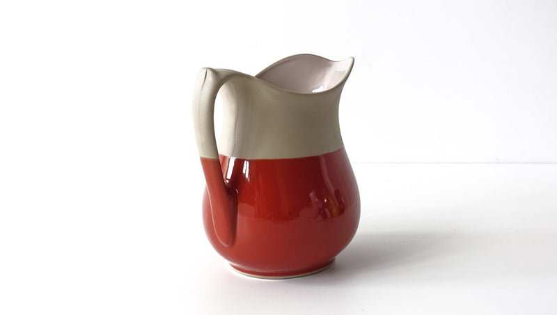 classic curvy slip cast brick red glazed  porcelain jug