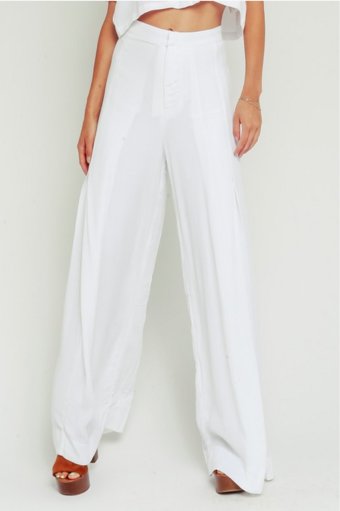 white flare pants zippered