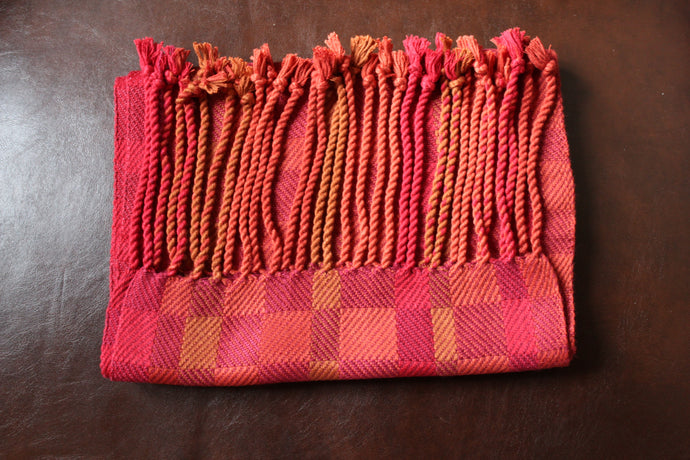 Hand-Woven Red/Orange blend of bamboo fibers for a scarf that is approximately 6 feet long and 10 inches wide.