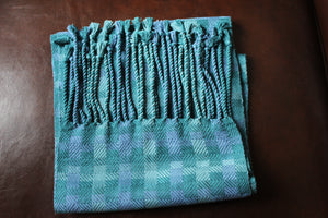 Hand-Woven Green with a hint of lavender blend of bamboo fibers for a scarf that is approximately 6 feet long and 10 inches wide.