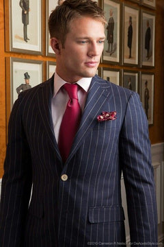 Blue pin stripe suit with red tie