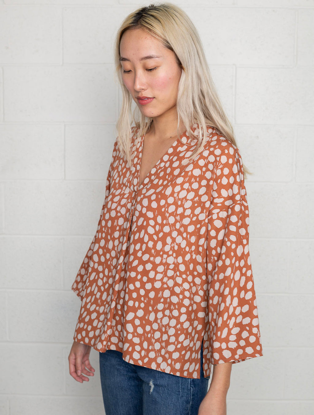 No Less Than V Neck Blouse in Rust Animal Print