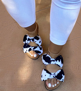 COWHIDE DOUBLE BOW SLIDE