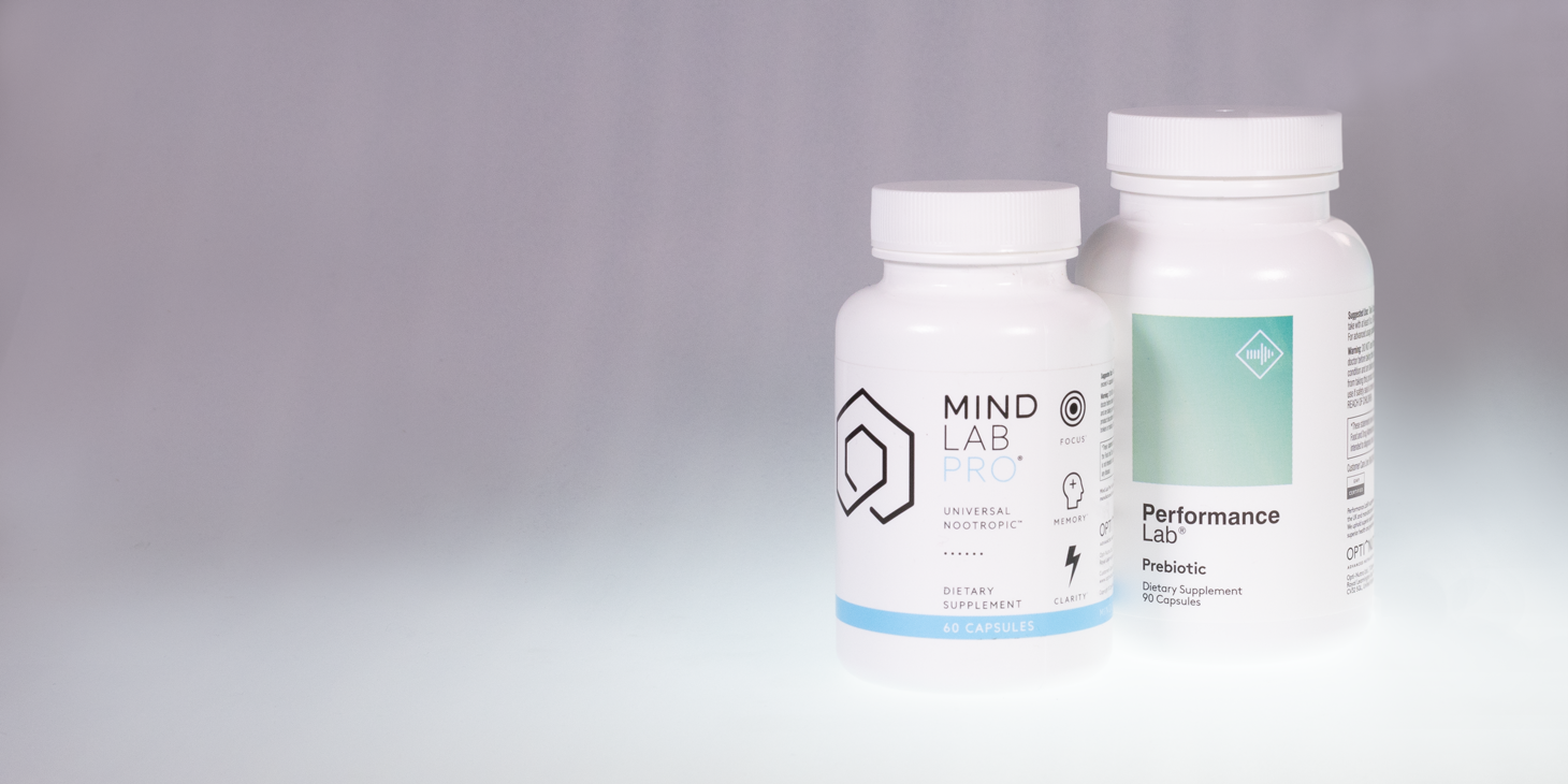 A bottle of Mind Lab Pro on the left of a bottle of Performance Lab Prebiotic