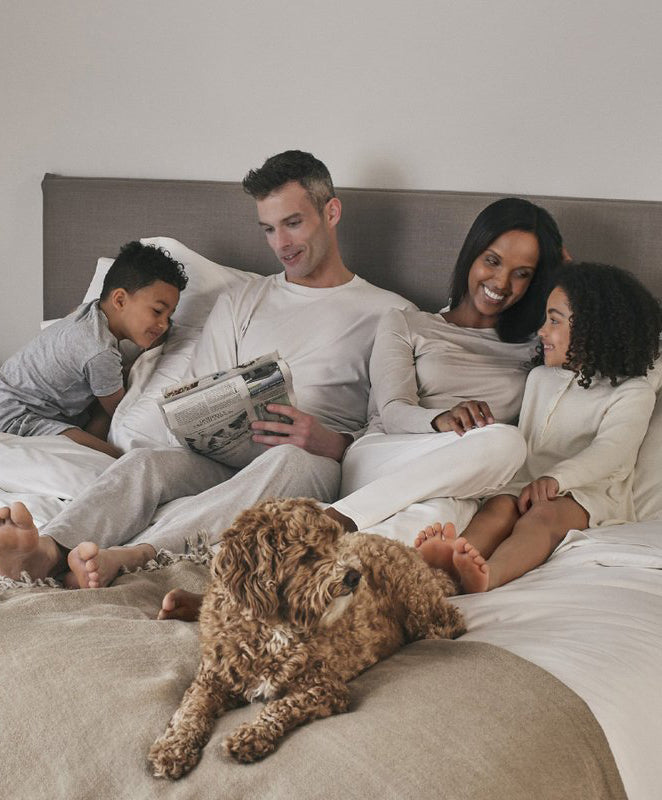 Four Seasons At Home Collection, son, father, mother, daughter and dog family on bed