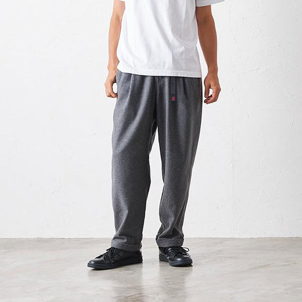 Man Wearing Gramicci Wool Blend Tuck Tapered Pants