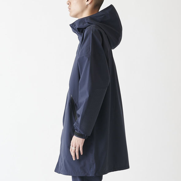 Model wearing Gramicci 3 Layer Big Flap Coat Side View