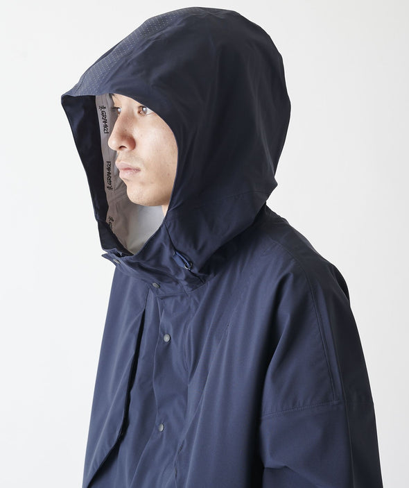 Model with hood up on Gramicci 3 Layer Big Flap Coat