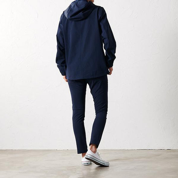 Model wearing Gramicci 4 Way Hooded Jacket in Navy GUJK-19S072 rear view