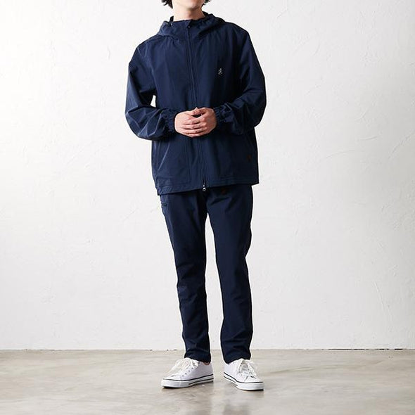 Model wearing Gramicci 4 Way Hooded Jacket in Navy GUJK-19S072 front view