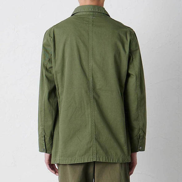 Model wearing Gramicci Cotton Twill Cover All Everyday Work Jacket (Olive) Rear View