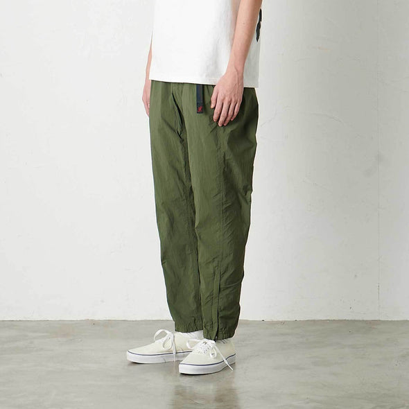 Model wearing Gramicci Lightweight Packable Truck Pants Side View