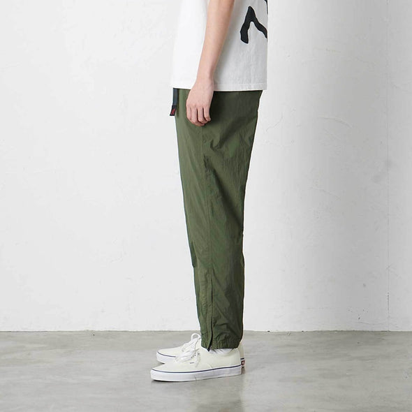 Model wearing Gramicci Lightweight Packable Truck Pants Side Profile