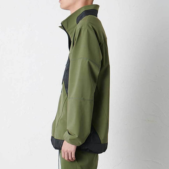 Model wearing Gramicci Stormfleece Zion Jacket Side Profile