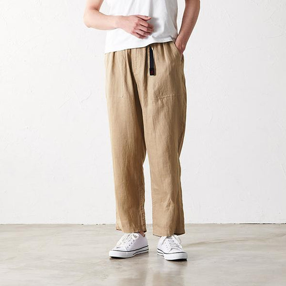 Model wearing Gramicci Linen Cotton Loose Tapered Pants front view