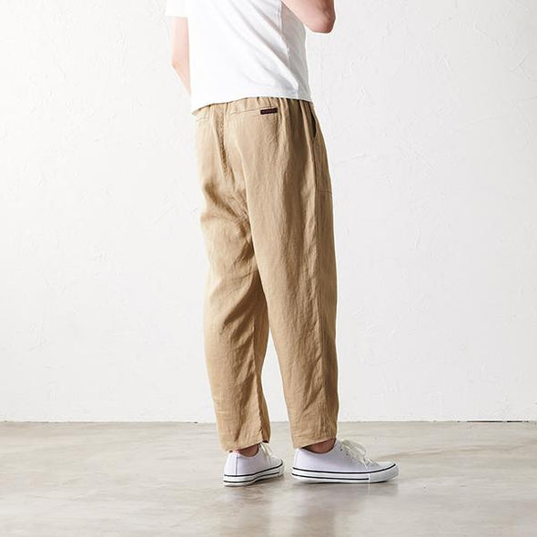 Model wearing Gramicci Linen Cotton Loose Tapered Pants rear view