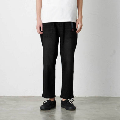 Model wearing Gramicci Loose Tapered Pants