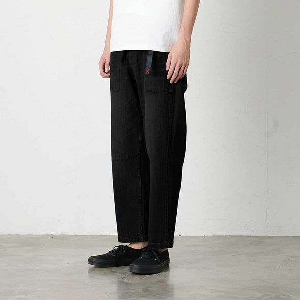 Model wearing Gramicci Loose Tapered Pants Side View