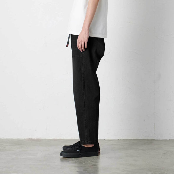 Model wearing Gramicci Loose Tapered Pants Profile View