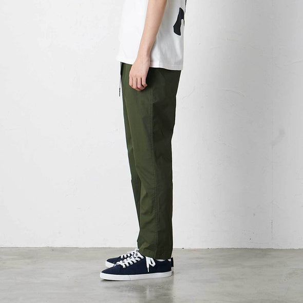 Model wearing Gramicci Weather Cotton Stretch NN-Pants Just Cut Side Profile