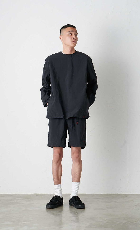 Model wearing Gramicci Packable Camp Long Sleeve Tee (Black)