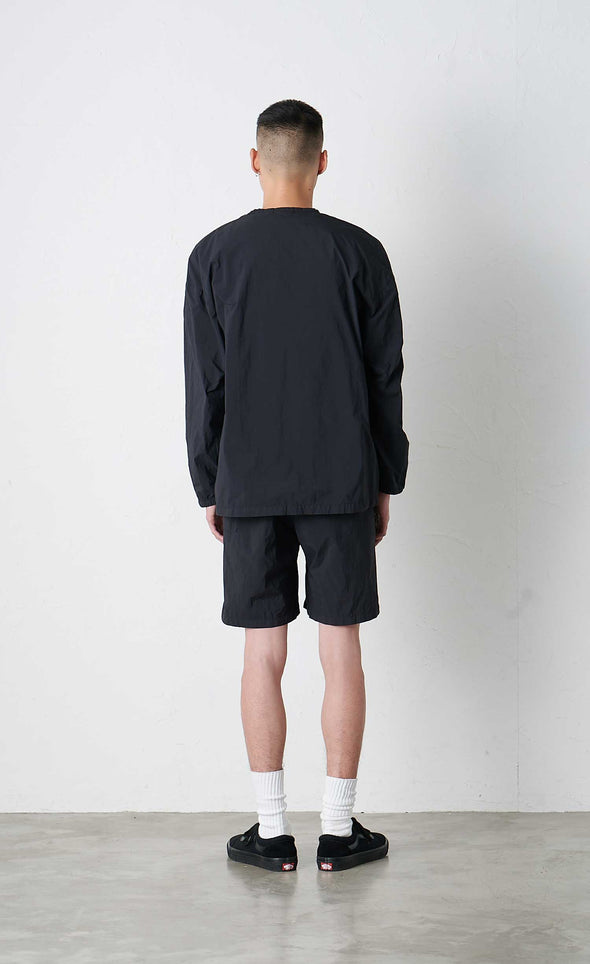 Model wearing Gramicci Packable Camp Long Sleeve Tee (Black) Rear View