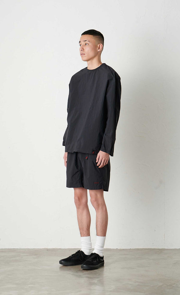 Model wearing Gramicci Packable Camp Long Sleeve Tee (Black) Side View