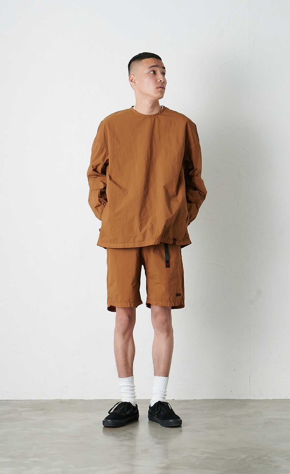 Model wearing Gramicci Packable Camp Long Sleeve Tee (Mocha)