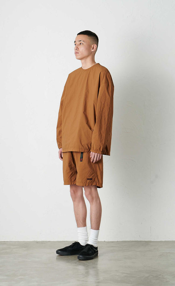 Model wearing Gramicci Packable Camp Long Sleeve Tee (Mocha) Side View