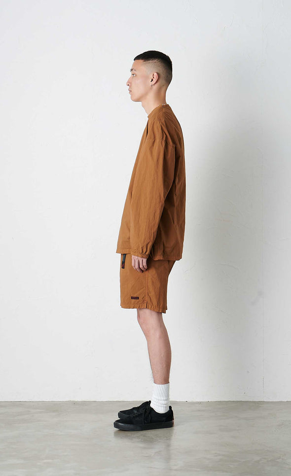 Model wearing Gramicci Packable Camp Long Sleeve Tee (Mocha) Side Profile