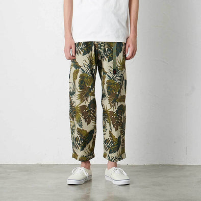 Model wearing Gramicci Weather Cotton Resort Pants (Botanical Beige)
