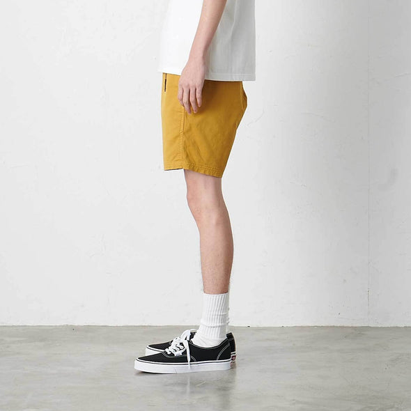 Model wearing Gramicci NN-Shorts Side Profile