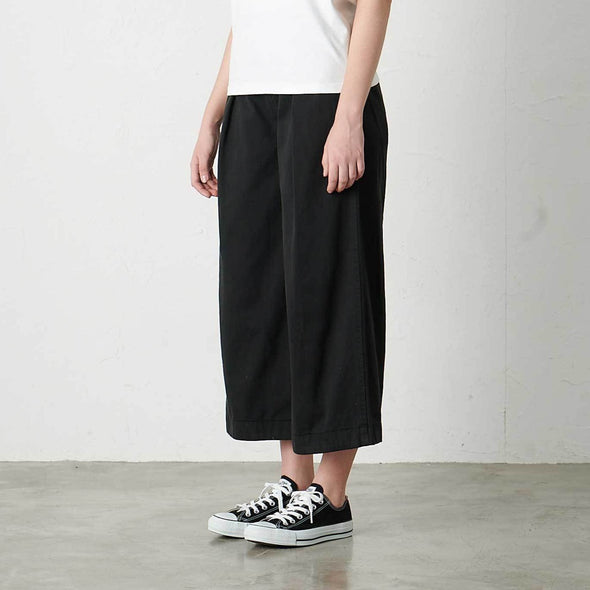 Model wearing Gramicci Women's Baggy Pants (Black) Side View