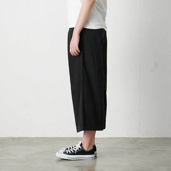 Model wearing Gramicci Women's Baggy Pants (Black) Side Profile