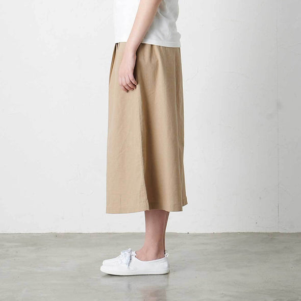 Model wearing Gramicci Linen Cotton Long Flare Skirt Side Profile