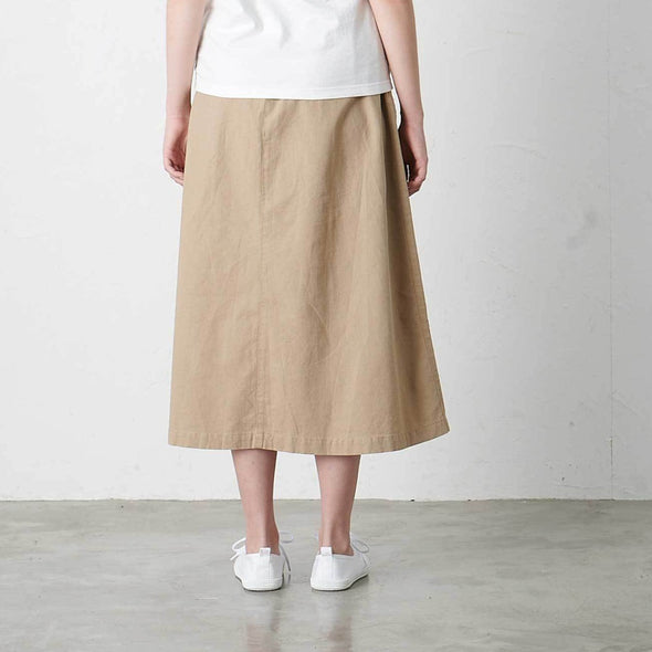 Model wearing Gramicci Linen Cotton Long Flare Skirt Rear View