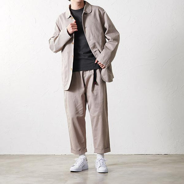 Man wearing Gramicci Cotton Twill Work Jacket in Chino GMJK-19F024