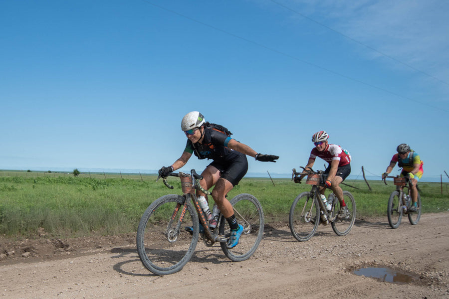 Group of bikers on a gravel trail