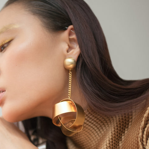 How to wear statement earrings by Two boss beads