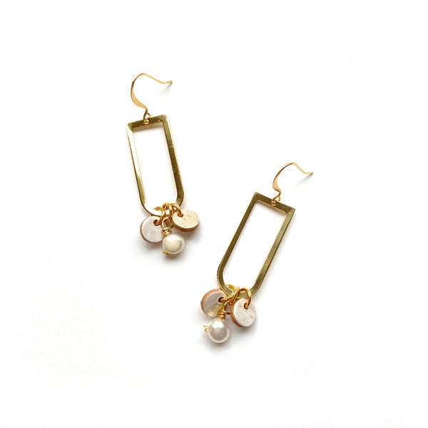Gold dangle earrings by Two boss beads