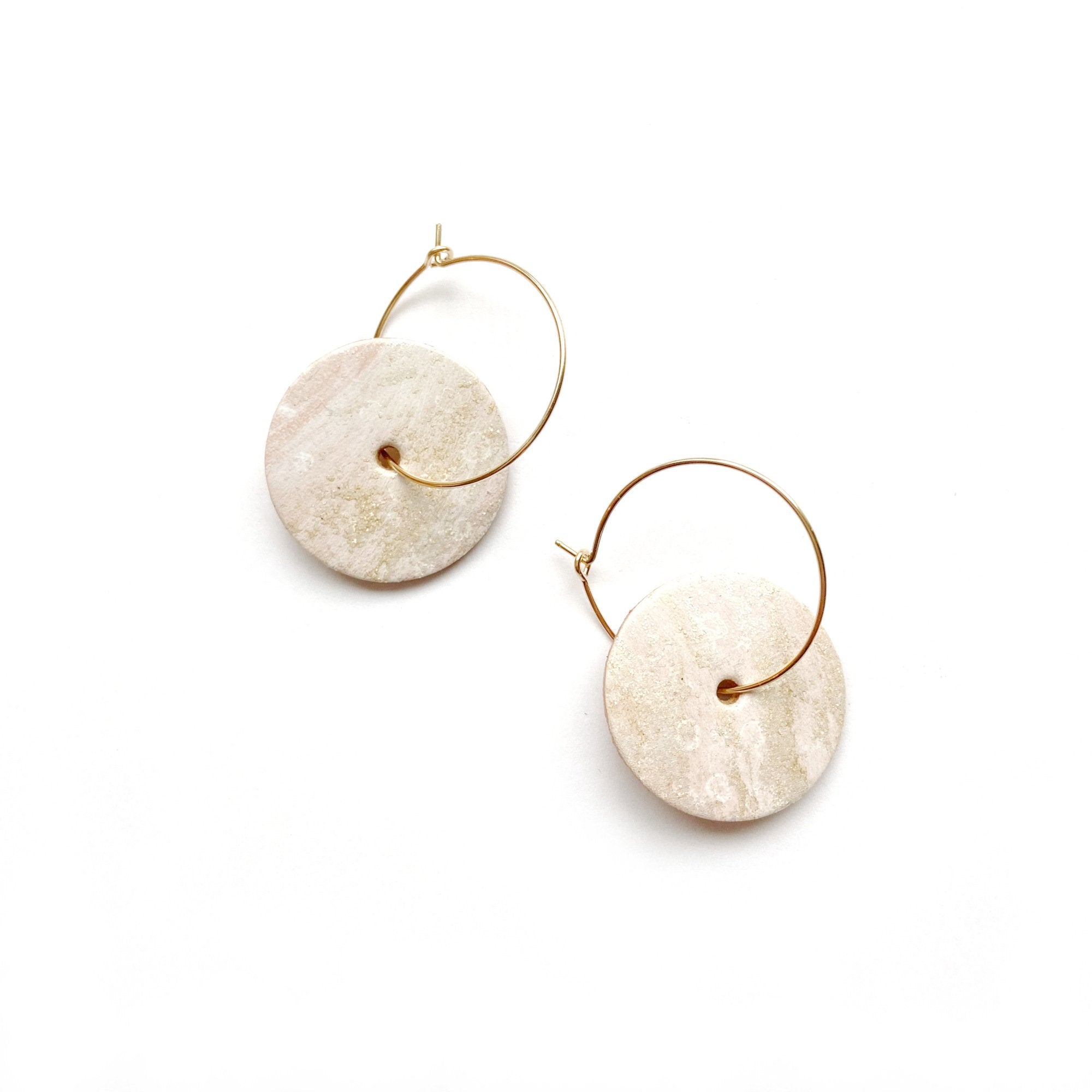 Gold hoop earrings by Two boss beads