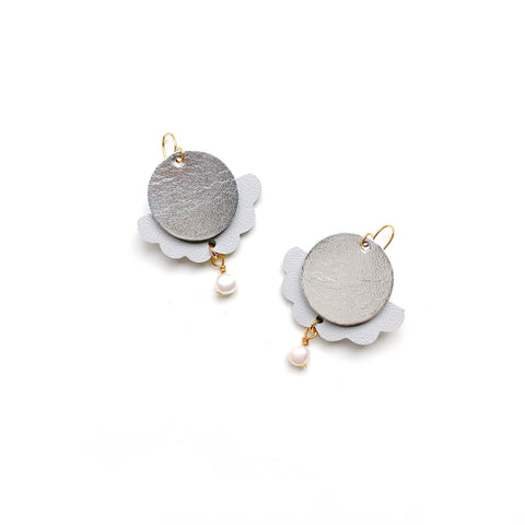 Statement earrings in silver leather