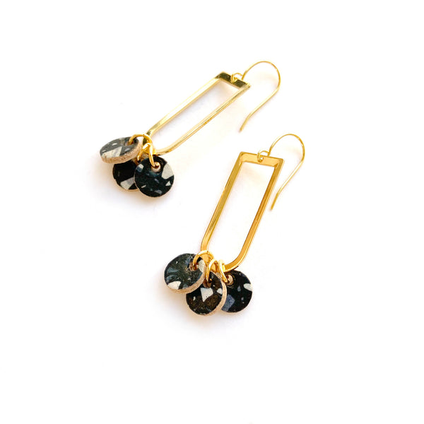 Gold dangle earrings in leather by Two boss beads
