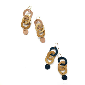 Two boss beads triple drop earrings