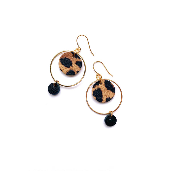 Leather circle drop earrings in animal print by Two boss beads