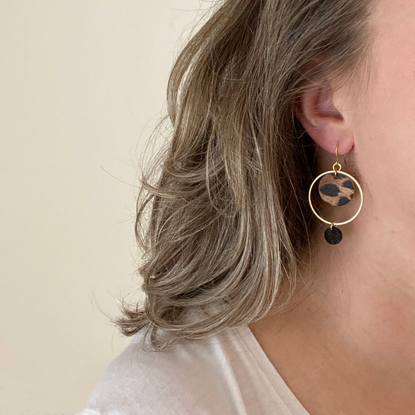 Leather circle drop earrings by Two boss beads